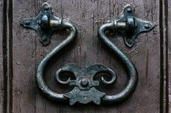 Old metal handle on a wooden door Stock Photography