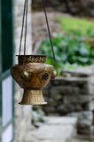 Old metal hanging incense-burner with swastika ornament , Asia royalty free stock photo