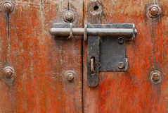 Old metal hasp on old vintage wooden door Royalty Free Stock Photo