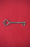 Old Metal Heart Shaped Key On Red Background Stock Images