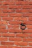 Old metal hook in red brick Stock Image