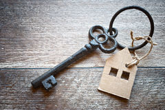 Old metal key with symbol of a family house Stock Image