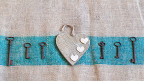 Old metal keys and white hearts Royalty Free Stock Photo