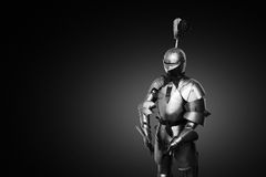 Old metal knight armour on a black background Royalty Free Stock Photos