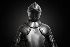 Old metal knight armour on black background Stock Photography