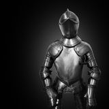 Old metal knight armour on black background Royalty Free Stock Photos