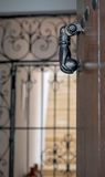 Old metal knocker on a door.  Royalty Free Stock Photo
