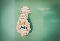 Old Metal Knocker on Green Door in Mdina, Malta. Space for your text Royalty Free Stock Image