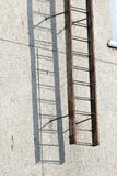 Old metal ladder and sulfur wall. Stock Photos