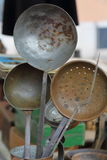 Old metal ladles Stock Photo