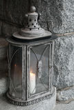 Old metal lamp with burning candle Royalty Free Stock Photography