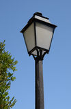 Old metal lamp post. Old fashioned lamp post against a blue sky Stock Images
