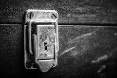 Old metal lock on rustic ancient box. Toned stock photo