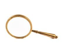 Old metal magnifying glass isolated Stock Photo