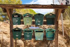 Old metal mailboxes. Old letters left on the mailbox. royalty free stock image