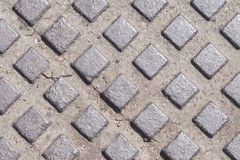 Old metal manhole texture with rectangles pattern, background macro, selective focus Stock Photography