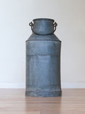 Old metal milk can Stock Images