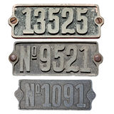 Old metal numbers. In white background Stock Photo
