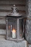 Old metal outdoor lamp with burning candle royalty free stock photos