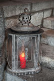 Old metal outdoor lamp with red candle Royalty Free Stock Images