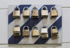 Old metal padlock hang on plate for lock out control cabinet ele Stock Photos