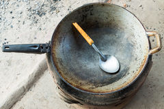 Old metal pan with ladle Stock Images