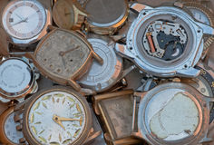 Old metal parts scrap wrist watch faces closeup. Back and front of old metal wrist watch faces Royalty Free Stock Photo