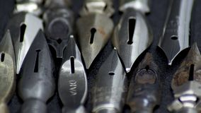Old metal pen nibs. Shot to some old ink stained pen nibs royalty free stock photos