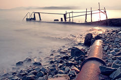 Old metal pipe and road to sea Royalty Free Stock Photo