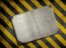 Old metal plate background with hazard stripes. Old metal plate background with hazardn yellow stripes stock image