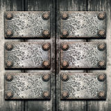 Old metal plate on metallic wall Royalty Free Stock Photos
