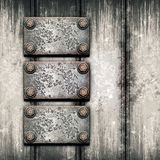 Old metal plate on metallic wall Stock Images