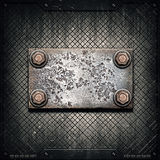 Old metal plate on metallic wall Stock Photos