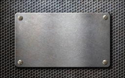 Old metal plate over grid metallic background. Metal plate over grid metallic background Stock Photo