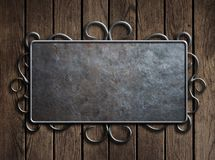 Old metal plate or sign on vintage wooden door Royalty Free Stock Images