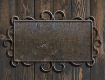 Old metal plate or sign on vintage wooden door 3d illustration. Old metal plate or sign on wooden door royalty free stock photography
