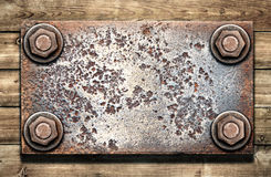 Old metal plate on wooden wall Royalty Free Stock Image