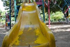 Old metal playground slide Stock Photos