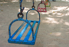 Old metal playground swing set Royalty Free Stock Images