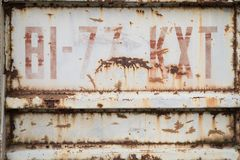 Metal background painted rusty surface with the inscription. royalty free stock image
