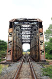 Old metal rail road bridge. Across the river Royalty Free Stock Photography