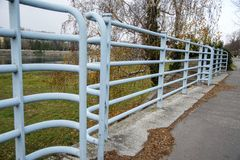Old metal railing in the park. Blue color. stock images