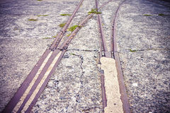 Old metal rails in an abandoned industrial area - toned image Royalty Free Stock Images