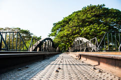The Old Metal Railway Bridge that leading to tree tunnel. Stock Photo
