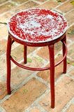 Old metal red chair. On brick floor Stock Photos