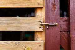 Old metal rustic latch on wooden gate close-up. Wooden gates royalty free stock photo