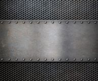 Old metal rustic plate over grid background royalty free stock photos