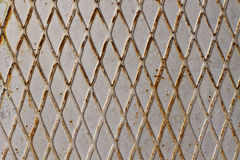 Old metal rusty background with grid. Stock Photography