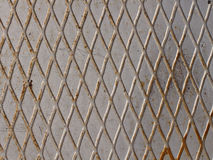 Old metal rusty background with grid. Stock Image