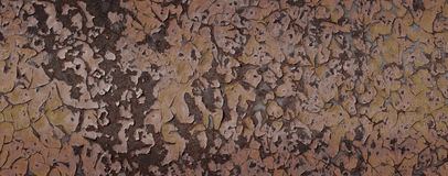 Old metal rusty with cracked paint. Royalty Free Stock Images